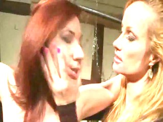 redhead receiving coarse lezdom treatment on her