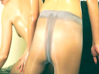 two sweaty snatches in nylon panties on couch