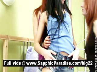 gorgeous brunette and redhead lesbians giving a