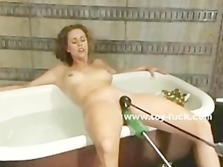 hairy bitch in water bathing while a mechanic